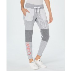 Calvin Klein Performance tepláky patchwork joggers orange